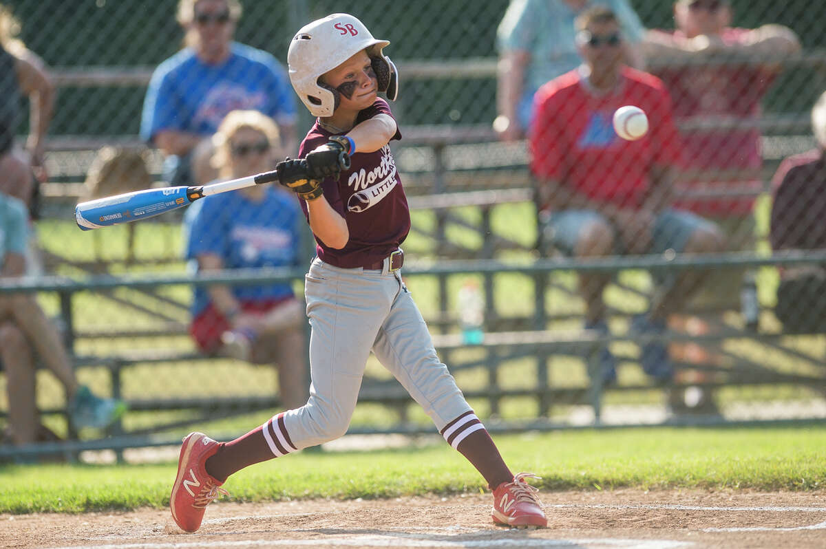 Wilson Miller's Hayes Gallihugh swings on a pitch during the Northeast Little League majors city championship game Thursday, June 10, 2021 at Plymouth Park in Midland. (Katy Kildee/kkildee@mdn.net)