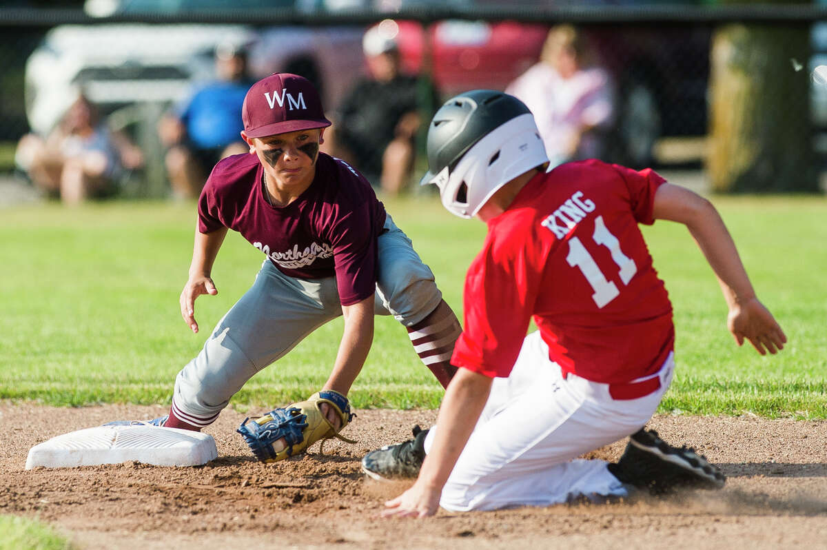 Wilson Miller's LJ Gallihugh tags out Feeny's Peyton King during the Northeast Little League majors city championship game Thursday, June 10, 2021 at Plymouth Park in Midland. (Katy Kildee/kkildee@mdn.net)