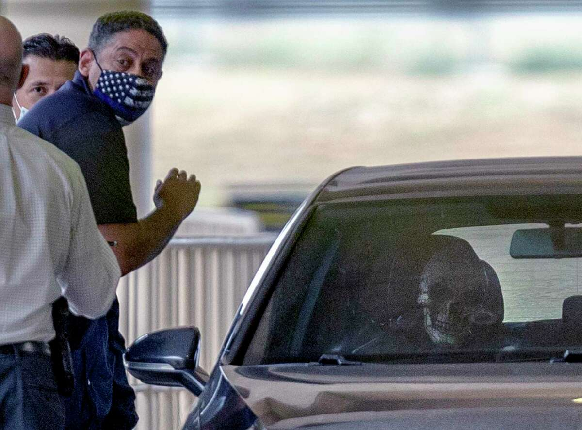 San Antonio police investigate what appears to be a skeleton or skeleton mask in a vehicle April 15 at San Antonio International Airport after Joe Gomez, 46, drove it the wrong direction in the passenger pickup lanes, got out and began firing.