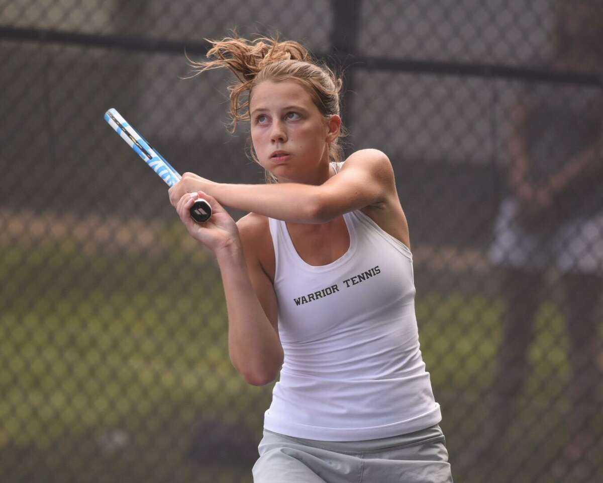 Wilton's Emma Caldwell hits a return during the CIAC Girls Tennis Invitational singles championship at Weslyan University in Middletown, Conn. on Thursday, June 10, 2021.