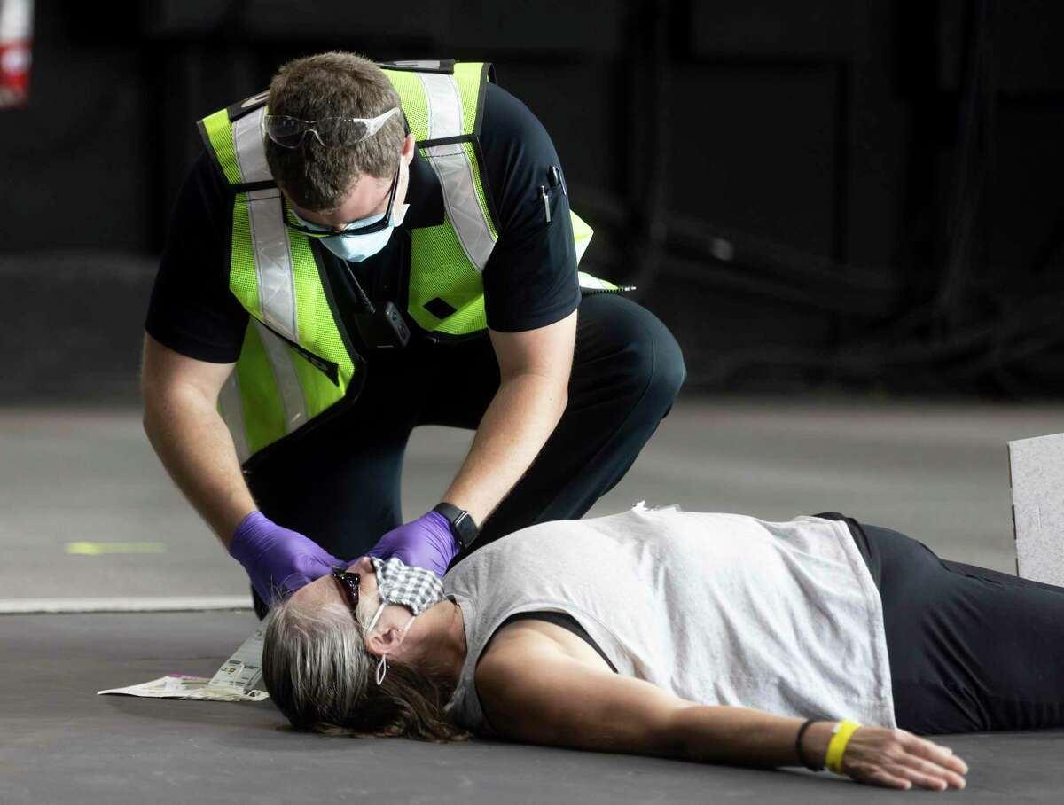 An EMT personnel tends to the aid of an