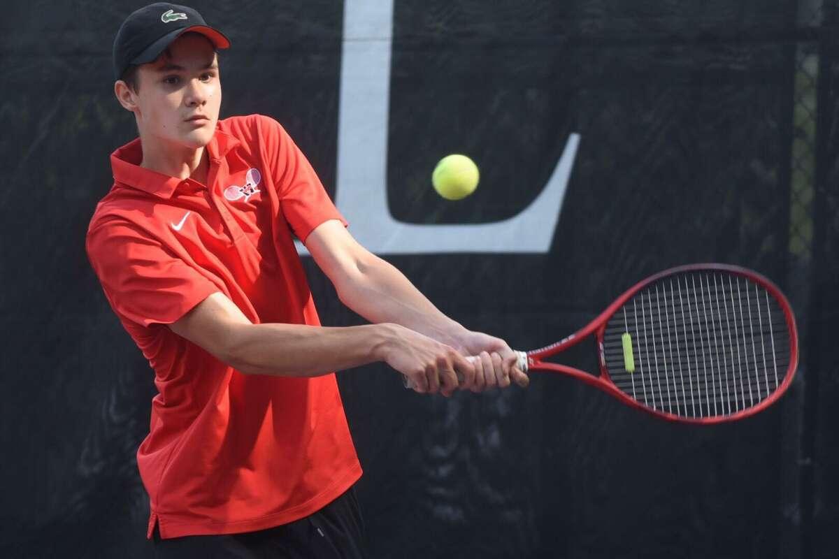 Warde's Petro Kuzmenok hits a return during the CIAC Boys Tennis Invitational singles championship at Weslyan University in Middletown on Thursday.