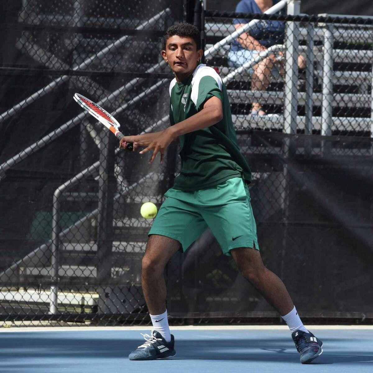 Norwalk's Prem Dave hits a return during the CIAC Boys Tennis Invitational singles championship at Weslyan University in Middletown on Thursday.