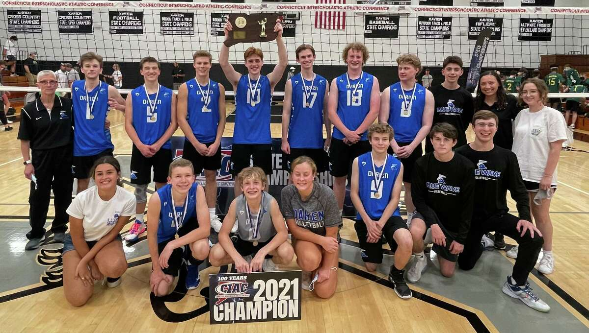 The Darien boys volleyball team celebrates after beating Enfield to win the CIAC Class L championship on Thursday in Middletown.