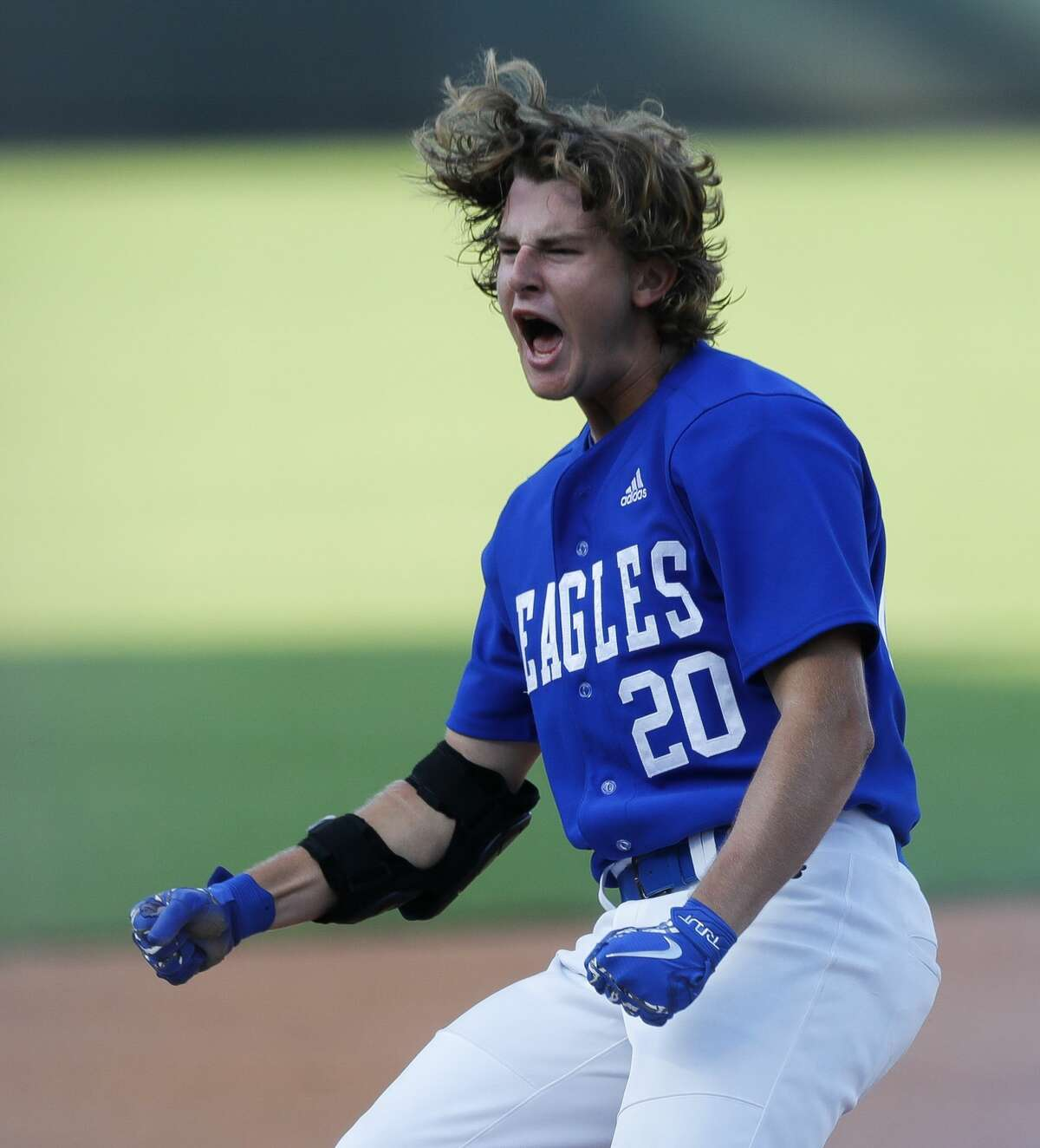 Blaine Huntley #20 of Barbers Hill reacts after hitting an RBI triple in the sixth inning of a Class 5A state semifinal game during the UIL State Baseball Championships at Dell Diamond, Thursday, June 10, 2021, in Round Rock.