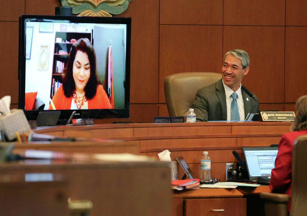 Mayor Ron Nirenberg chuckles as the video chat with Councilwoman Rebecca Viagran stalls during a City Council meeting in April. Viagran will lead workforce development and educational partnerships at Texas A&M-San Antonio starting in July.