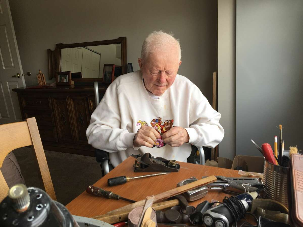 The author's energetic and wise father, Frank Crehan, works with his tools often repairing something or making a gift for someone else.