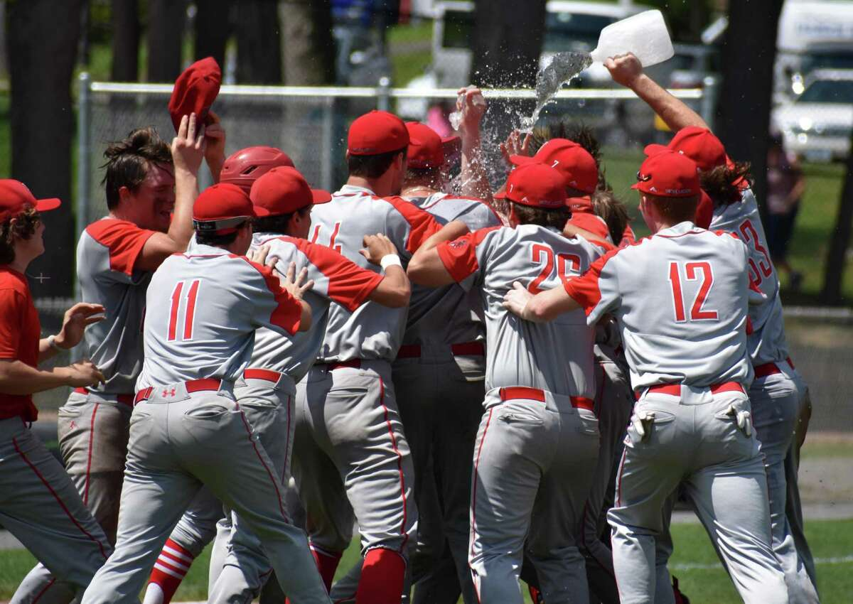 Northwestern celebrates beating Woodland, 3-2, in the Class M baseball semifinals at Muzzy Field, Bristol on Wednesday, June 9, 2021.
