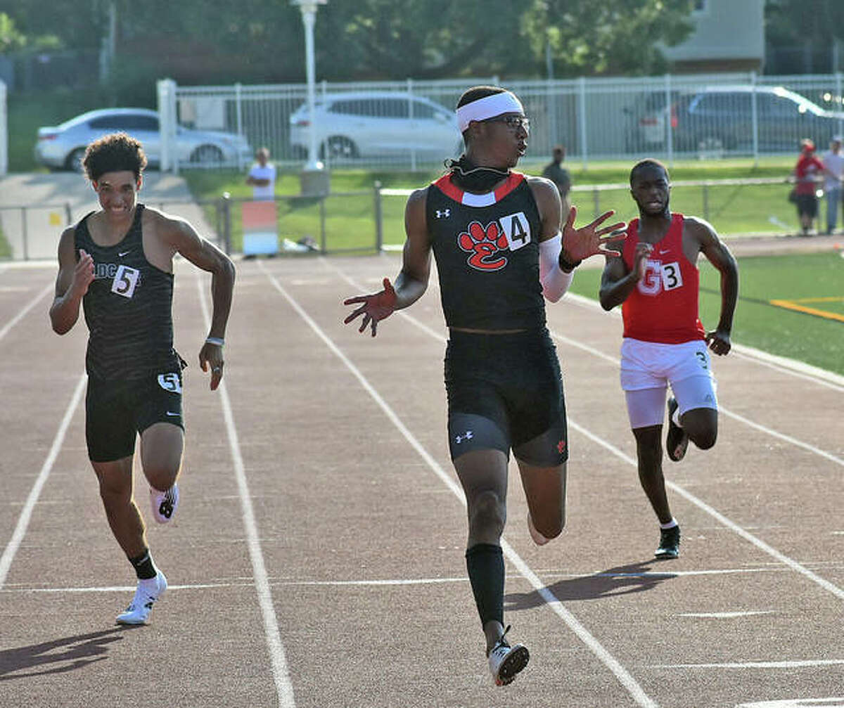 Edwardsville's Brandon Battle checks his time as he crosses the finish line for the victory in the 200-meter dash at the Class 3A Bloomington High School Sectional on Thursday.