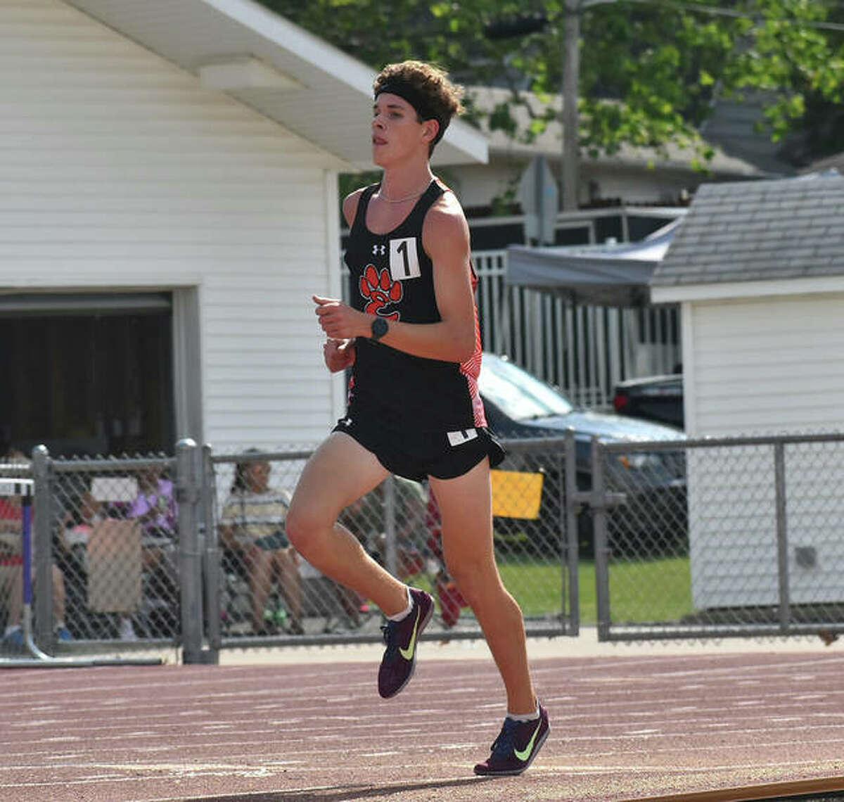 Edwardsville's Geordan Patrylak in complete control of the 3,200-meter run on Thursday in Bloomington.