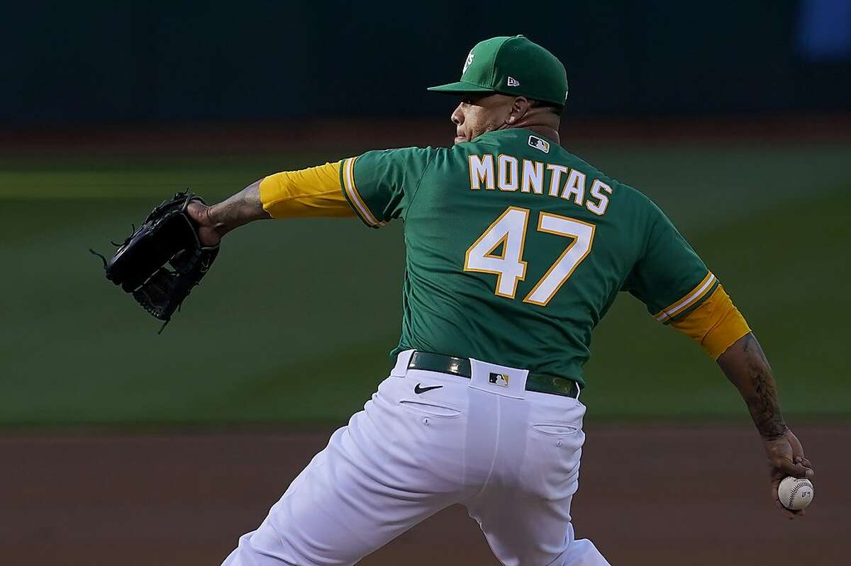 Oakland Athletics' Frankie Montas throws to a Kansas City Royals batter during the first inning of a baseball game in Oakland, Calif., Thursday, June 10, 2021. (AP Photo/Jeff Chiu)