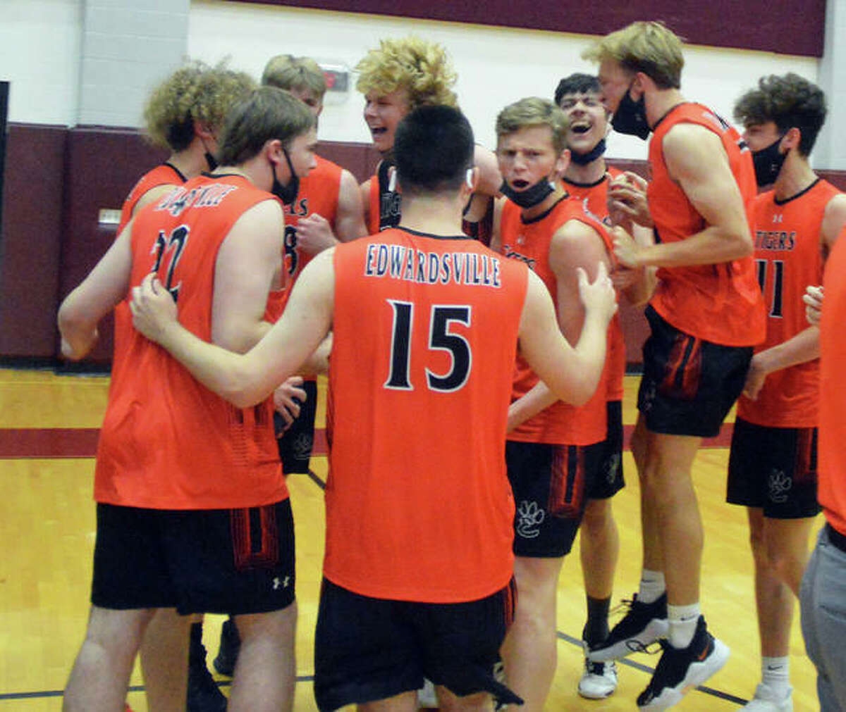 Edwardsville players celebrate their three-set victory over Althoff on Thursday in the Belleville West Sectional championship match.
