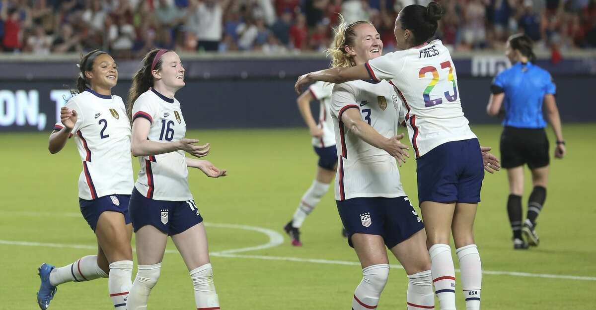 U.S. Women's National Team players Samantha Mewis (3) and Christen Press (23) celebrate Mewis' goal with Press' corner kick during the second half of the 2021 Summer Series match against Portugal Thursday, June 10, 2021, at BBVA Stadium in Houston. The U.S. Women's National Team defeated Portugal Women's National Team 1-0.