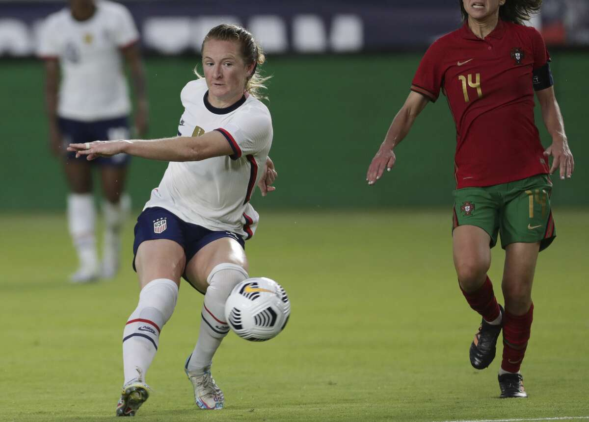 U.S. Women's National Team midfielder Samantha Mewis (3) takes a shot at the goal during the first half of the 2021 Summer Series match against Portugal Thursday, June 10, 2021, at BBVA Stadium in Houston.