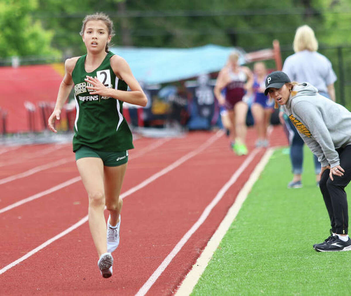 Father McGivney's Kaitlyn Hatley runs alone in second place in the 1,600 meters at the Belleville Althoff Sectional.