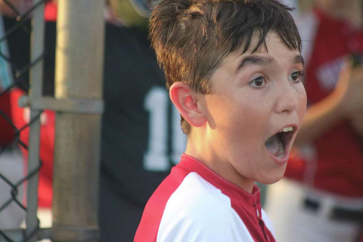 Nationals player Sam Burke cheers on his teammates during Thursday night's Majors city championship game.