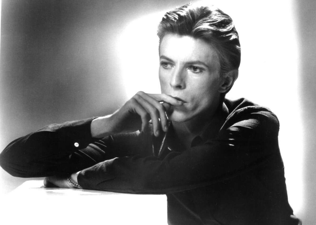 """David Bowie: The life story you may not know David Bowie was one of the most intriguing musicians of our time, reinventing himself continually and influencing countless others along the way. He made more than two dozen albums, including """"Blackstar,"""" which was released just two days before his death. He played more than a dozen instruments, including a right-handed guitar even though he was left-handed. Bowie's concept album, """"The Rise and Fall of Ziggy Stardust and the Spiders from Mars,"""" introduced the world to his glam-rock persona in 1972. Four years later, he starred in the film """"The Man Who Fell to Earth.""""By the end of the 1970s, he kicked his drug habit and appeared in """"The Elephant Man"""" on Broadway. Two years after suffering a heart attack in 2004, Bowie performed three songs on stage with Alicia Keys in New York. It would be his last performance. In the year following his death, Bowie and """"Blackstar"""" won four Grammy awards. In 2019, the BBC reported that David Bowie had won its viewer poll for greatest entertainer of the 20th century, beating out Charlie Chaplin, Billie Holiday, and Marilyn Monroe. """"I like crazy art and, most of the time, out-there music,"""" Bowie once said. """"Rather than having a hit song these days, I like the idea that I'm in there changing the plan of what society and culture look like, sound like. I did change things; I knew I would. It feels great, and very rewarding."""" Bowie's theatrical flare, creativity, sexual ambiguity, and incredible music kept the public endlessly interested. Stacker has compiled a list of 25 things about David Bowie's..."""