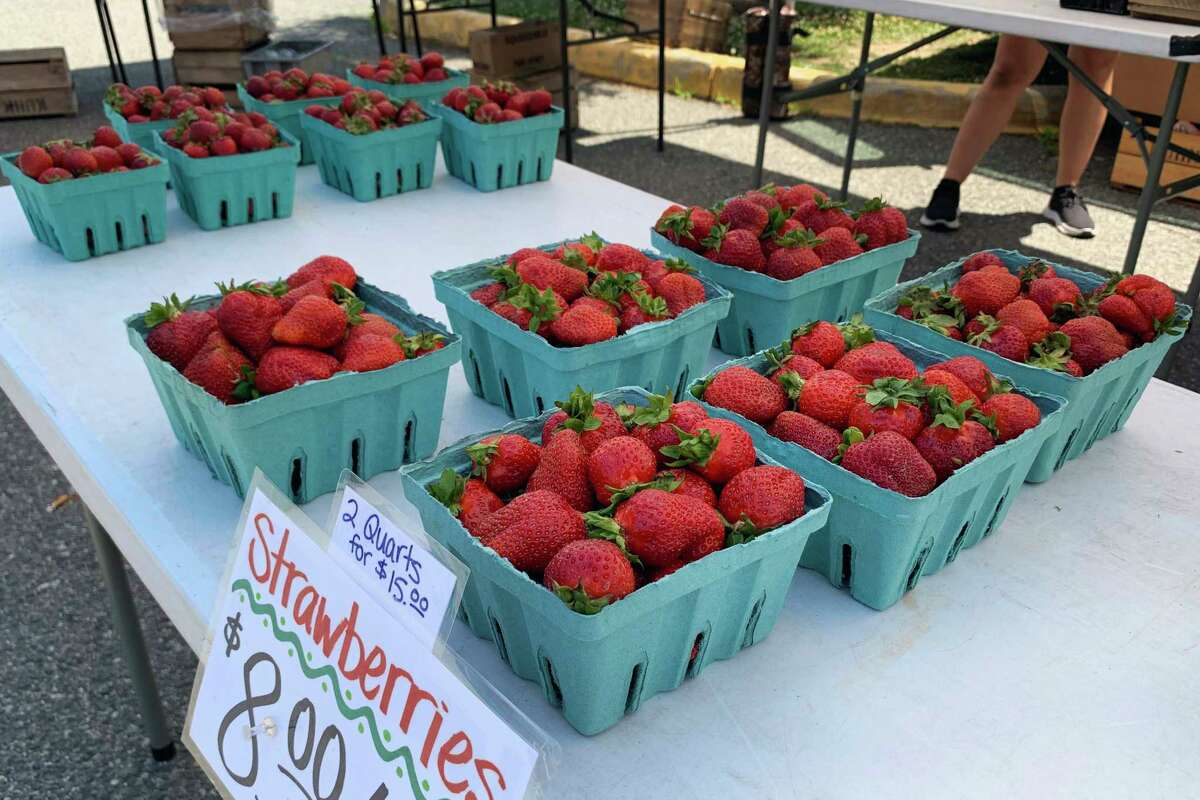 Strawberries for sale at the Kuhn Orchards (Cashtown, PA.,) booth at the Fairlington Farmers Market in Arlington, Virginia on June 6, 2021.