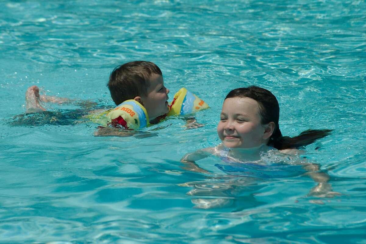 J.J. Strader and Nora Strader enjoy a swim in Fairmont Pool in La Porte.