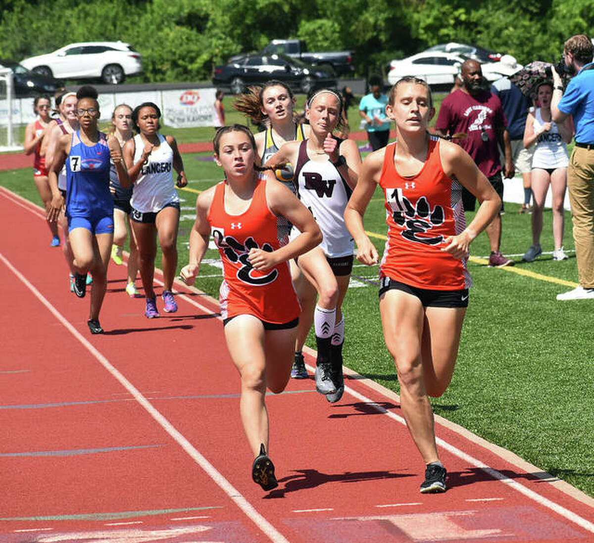 Edwardsville teammates Olivia Coll, left, and Kaitlyn Loyet lead the pack during the 3,200-meter run the Southwestern Conference Meet at Collinsville.