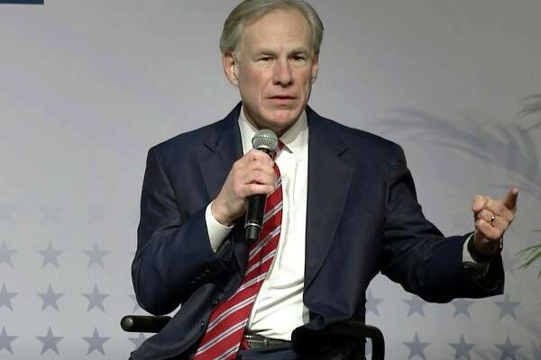 In this photo from March 7, 2021, Texas Gov. Greg Abbott announced the reopening of Texas by lifting state capacity limits on businesses and the masking requirement. Abbott said Thursday that Texas would build a border wall on its own without federal assistance. (Lynda M. Gonzalez/Dallas Morning News/TNS)