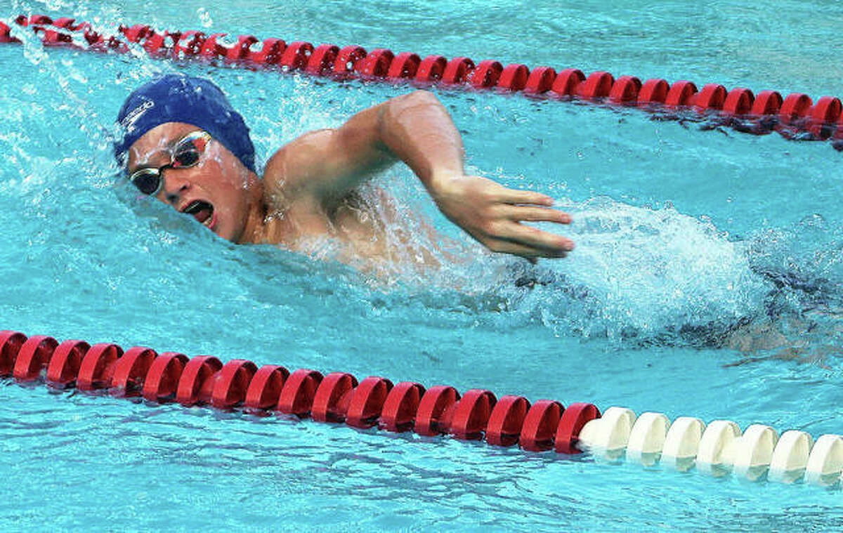 Stephen Stobbs of Summers Port swims the 50-yard freestyle for the Sharks in their SWISA meet against Montclaire Thursday in Godfrey. He won the race and later won the 50-yard butterfly.