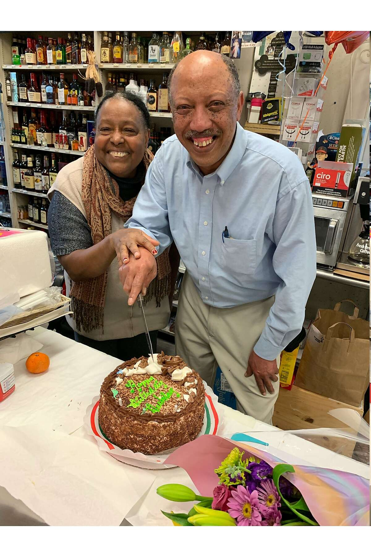 Petros Yohannes (right), owner of Franklin Market, in an undated photo. Yohannes was stabbed multiple times in an assault on June 2.