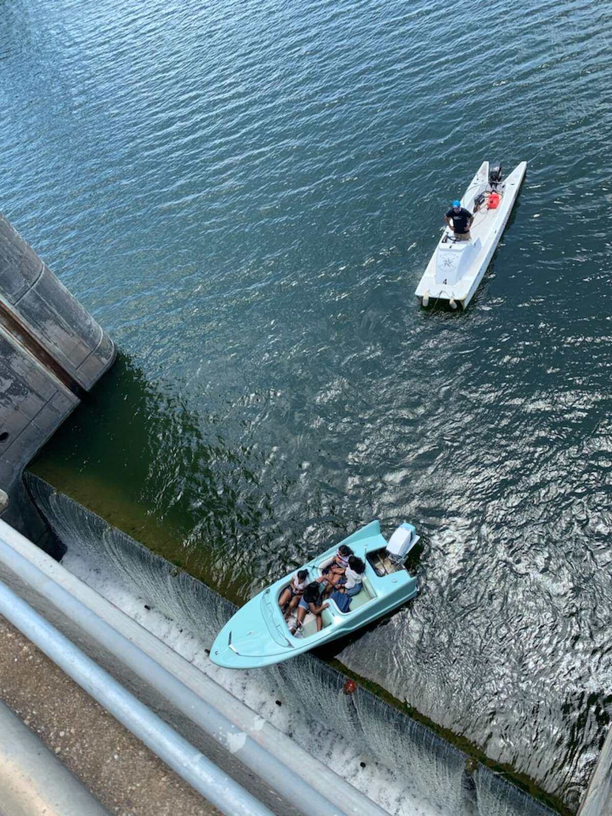 Austin-Travis County EMS responded to calls to rescue boaters who were in danger of falling over the edge of a Texas dam.