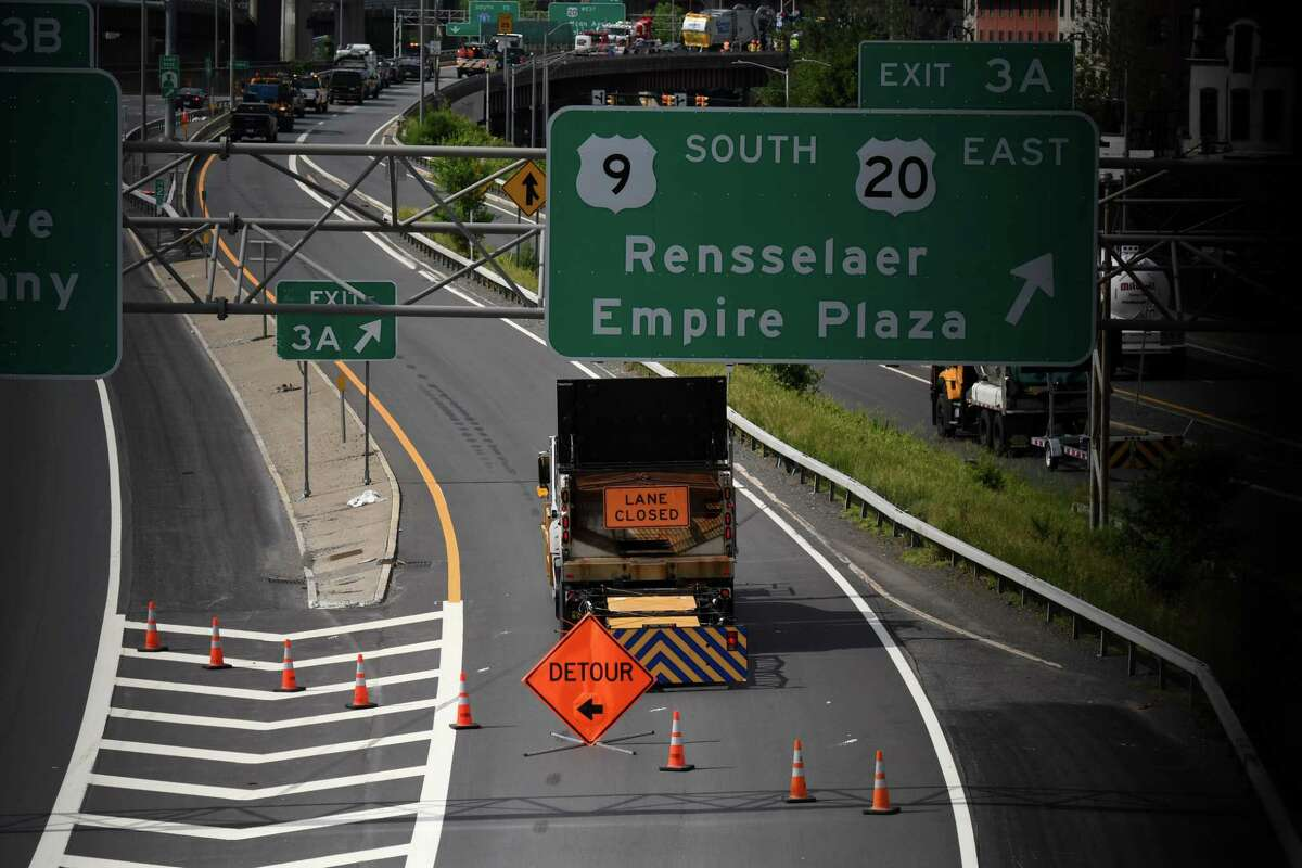 The southbound ramp at Exit 3A and 3B on Interstate 787 was closed after a garbage truck overturned on Friday morning, June 11, 2021, in Albany, N.Y. The state Department of Transportation said the crash has closed all southbound routes to both the Empire State Plaza and the Dunn Memorial Bridge to Rensselaer. (Will Waldron/Times Union)