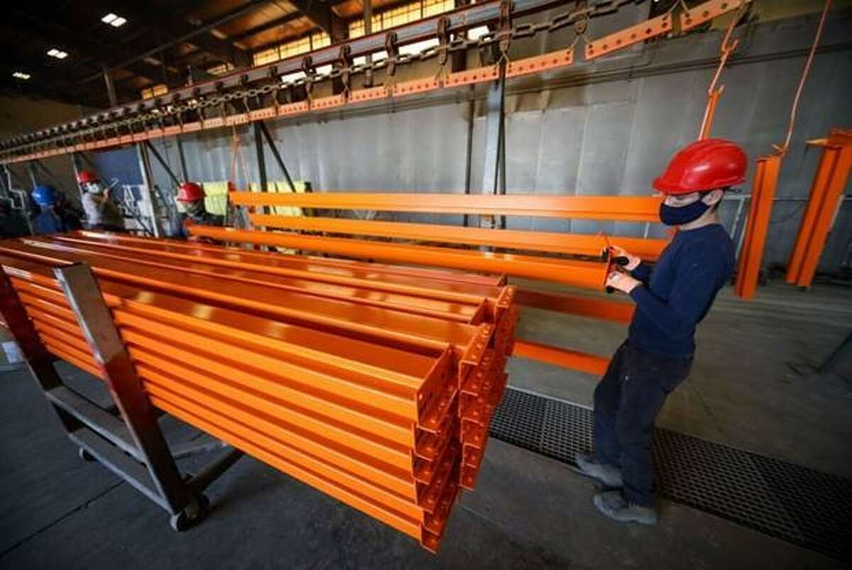 Employees prepare finished rack for shipment at Hannibal Industries in northwest Houston. The Los Angeles-based company opened a Houston location at 6501 Bingle Road in 2016.