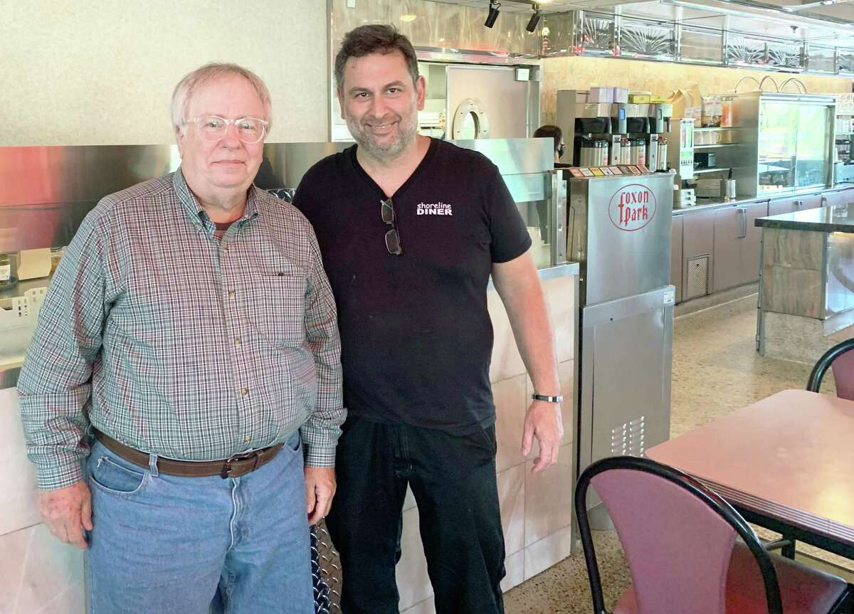 Career coach Garrison Leykam, left, is seen with Shoreline Diner owner Nico Anthis, right, at the Guilford eatery.