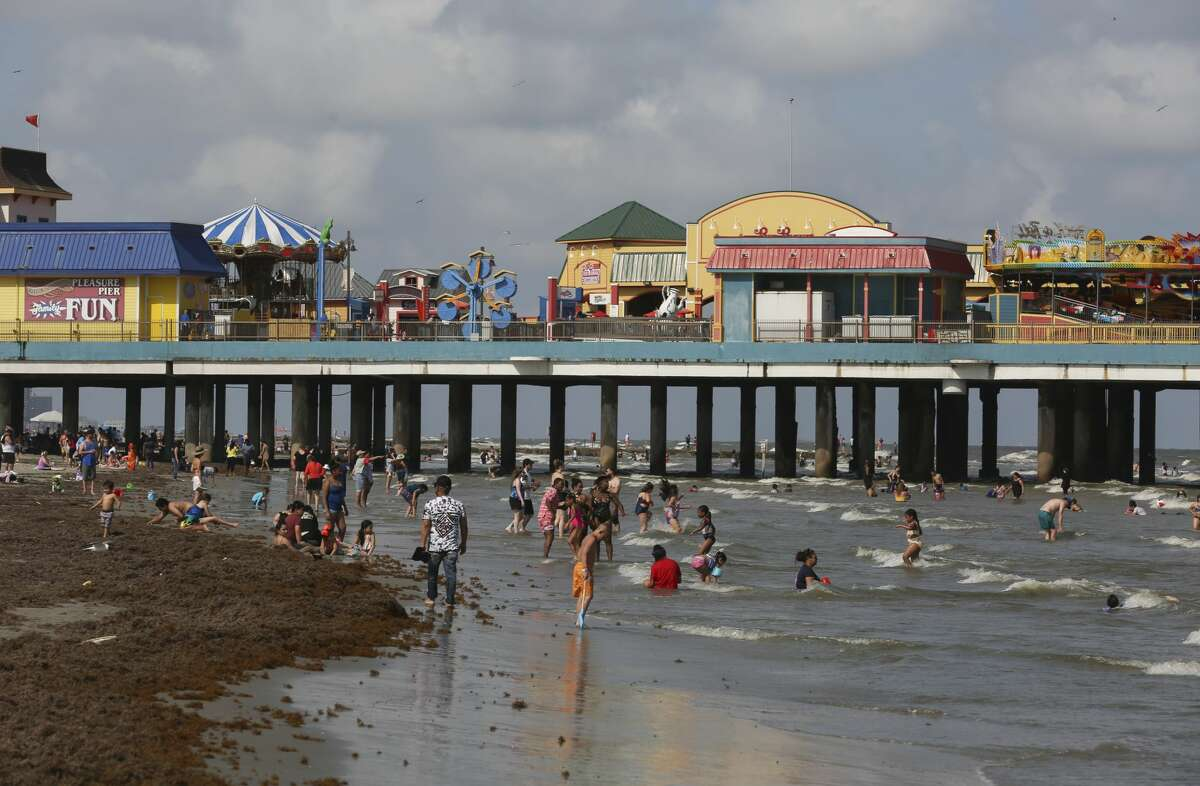 Beach goers near Pleasure Pier in Galveston, Memorial Day Weekend 2019. Data show that people celebrated Memorial Day 2021 closer to home.