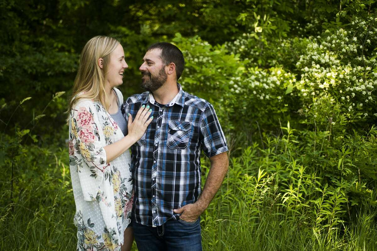 Samantha and Paul Burback pose for a portrait Wednesday at their home in Saint Charles. The couple met in 2019 through the Children's Grief Center of the Great Lakes Bay Region in Midland. (Katy Kildee/kkildee@mdn.net)