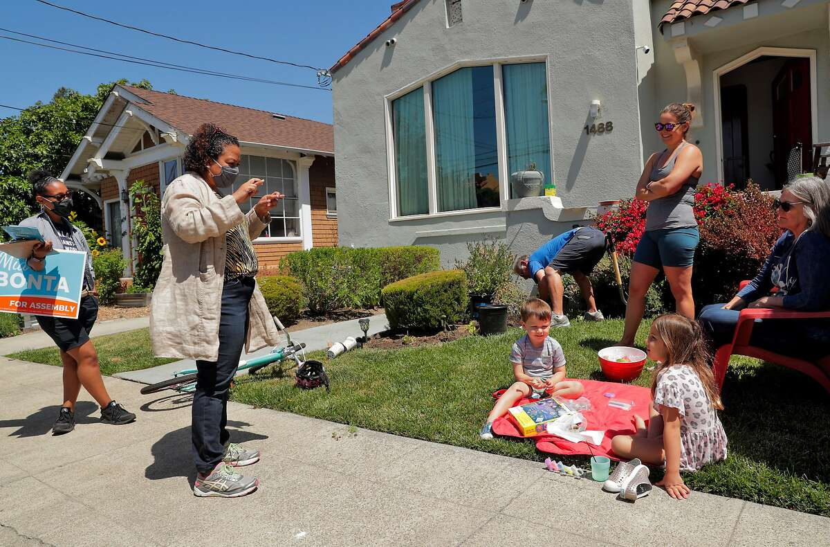 Mia Bonta speaks with the Gesicki family in Oakland's Glenview district. She is running for the East Bay Assembly District seat vacated by her husband, state Attorney General Rob Bonta.