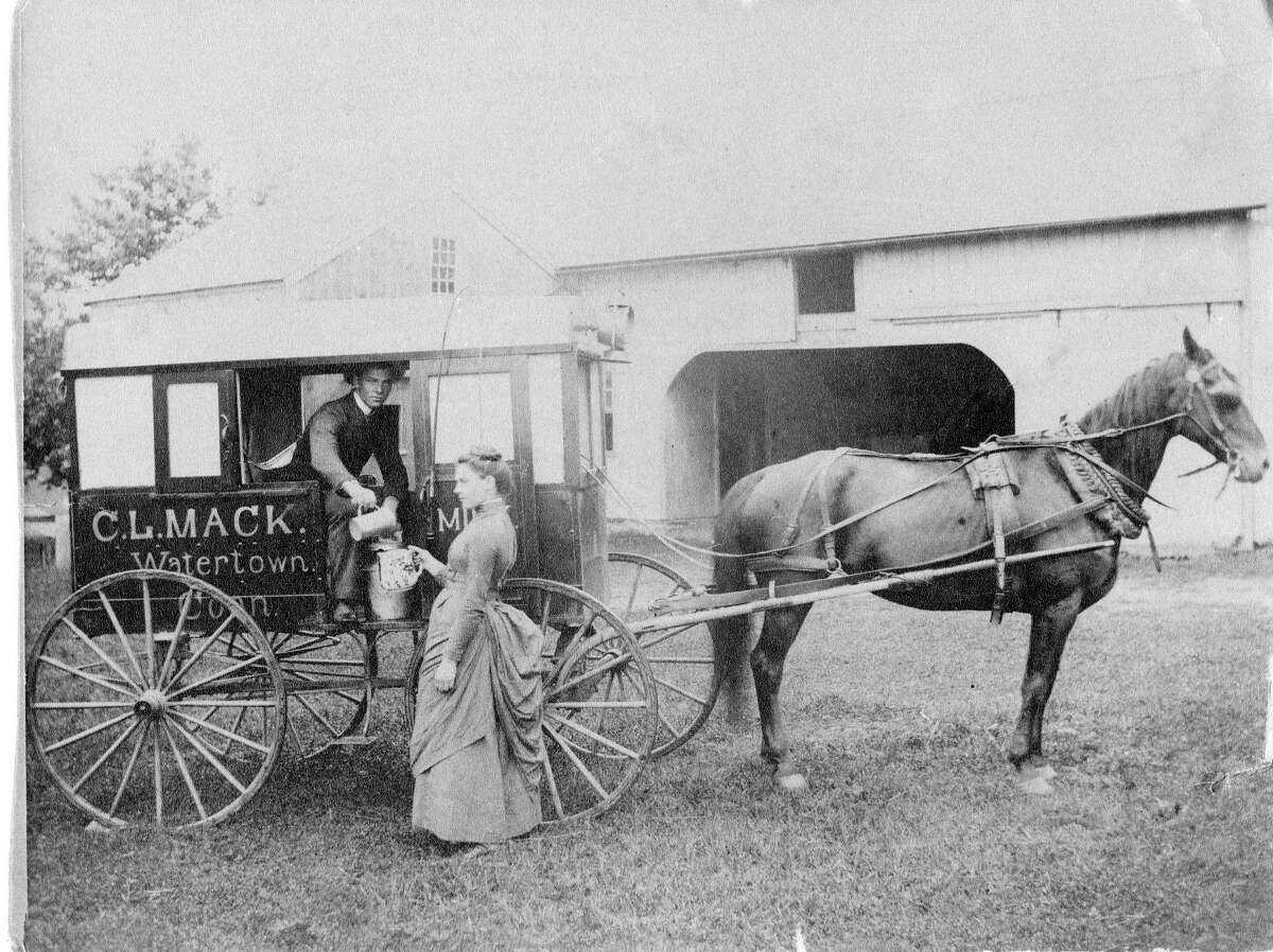 Frank and Lucy Mack, children of Calvin Lauriston Mack, Watertown Dairy Farmer, are pictured delivering milk around 1900. It's part of a new Watertown History Museum exhibit,
