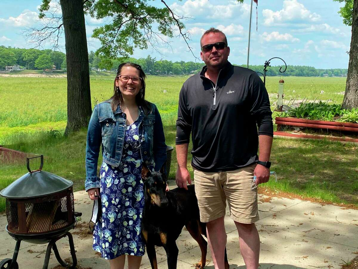 Becca Marcott, a disaster case manager with Long Term Disaster Recovery, poses for a picture with flood victim Sean Murphy. (Photo provided)
