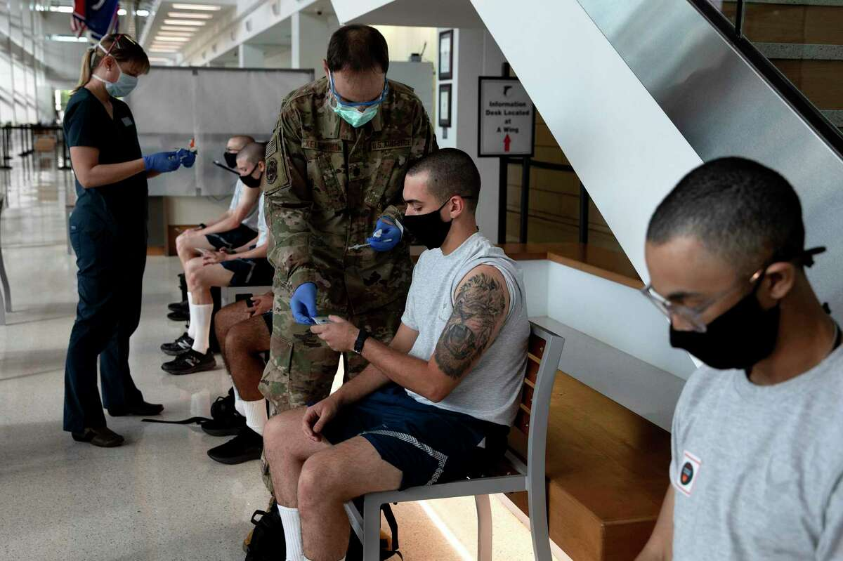 Air Force recruits in their first week of basic training receive the first dose of the Pfizer vaccine at Joint Base San Antonio-Lackland. The vaccine is optional for all recruits.