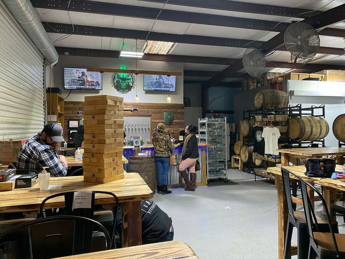 Excalibur Brewing, 26510 A Border St., a brewery in Old Town Spring with an outdoor seating area for drinking.