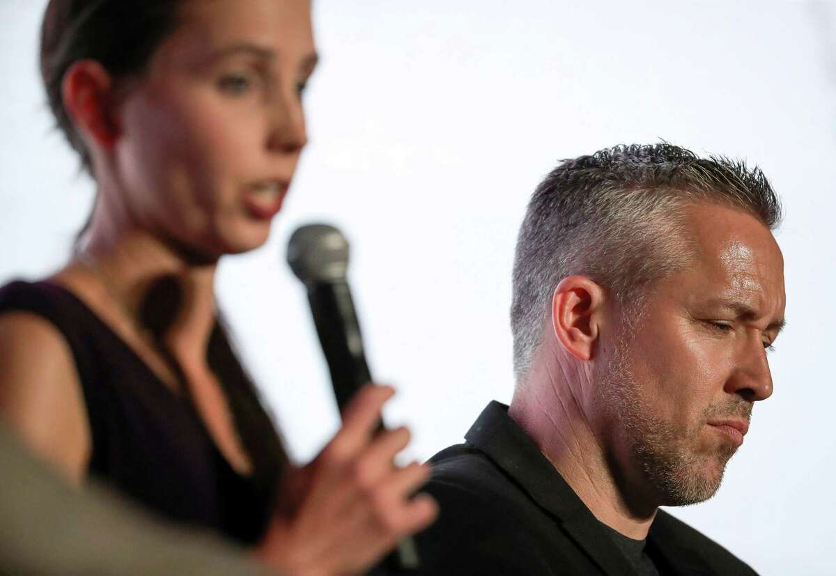 J.D. Greear, right, president of the Southern Baptist Convention, listens as Rachael Denhollander, an abuse survivor, speaks about sexual abuse during a panel discussion on the eve of the SBC's annual meeting on June 10, 2019, in Birmingham.