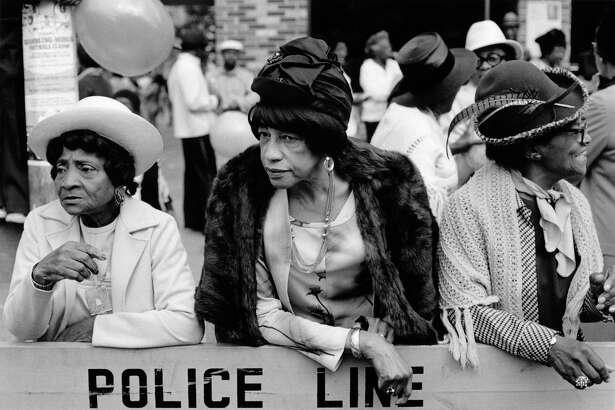 """Dawoud Bey's """"Three Women at a Parade, Harlem, NY"""" (1978)."""