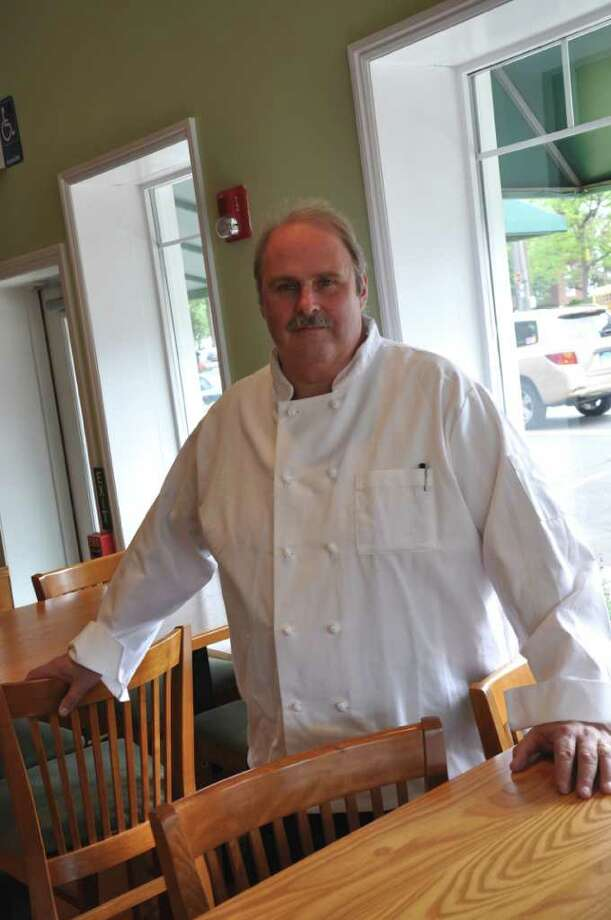 "James Grace, general manager and executive chef of The Greenhouse Grill, stands in his new restaurant, which is a ""combination of a steakhouse and a new American grill."" The Greenhouse Grill is located at 12 Unquowa Place. Photo: Kirk Lang / Fairfield Citizen"