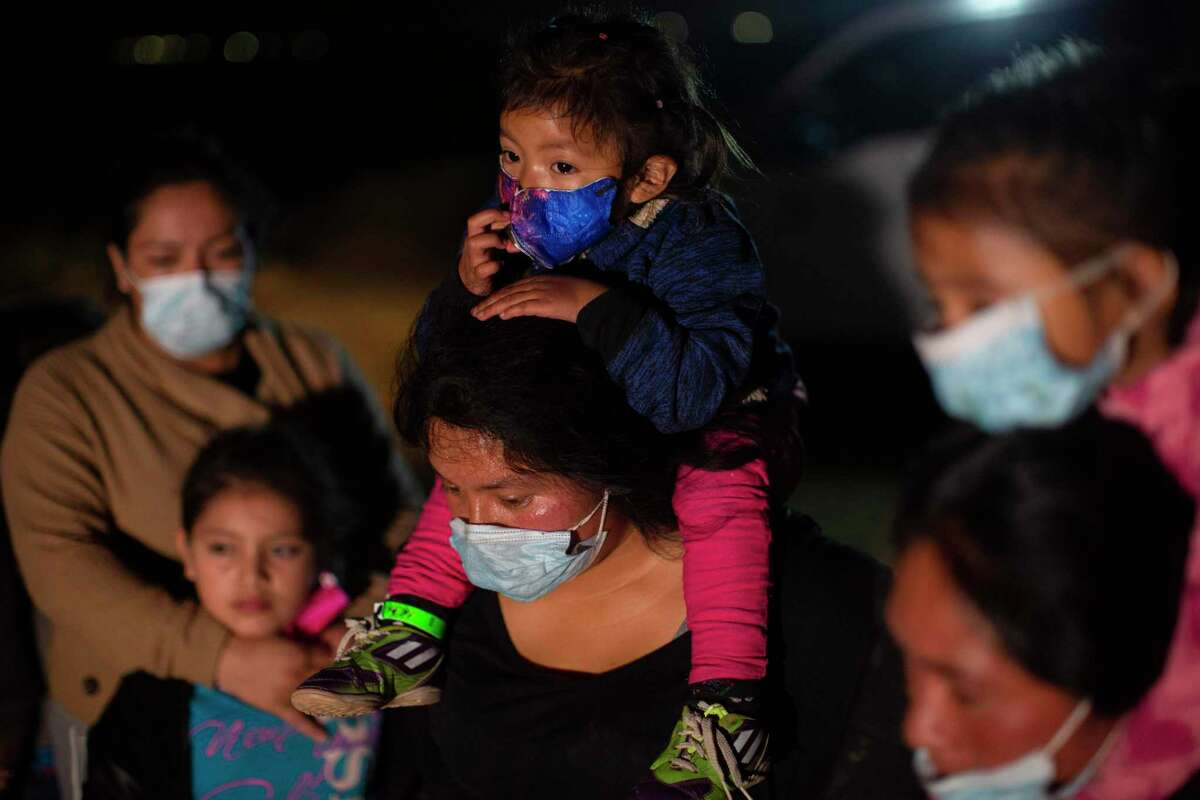 Migrant families coming from Guatemala wait at a U.S. Border Patrol intake site in March. Addressing root causes for immigration in the Northern Triangle means supporting existing governments, as well as economic and educational investment.