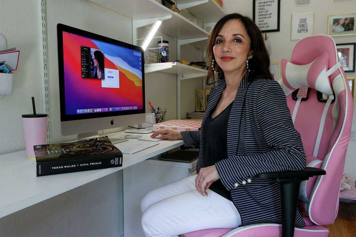 Working from home, attorney Marcella Della Casa often dresses in what's become known as a Zoom outfit, consisting of professional-looking clothing up top and more comfy bottoms and footwear below.