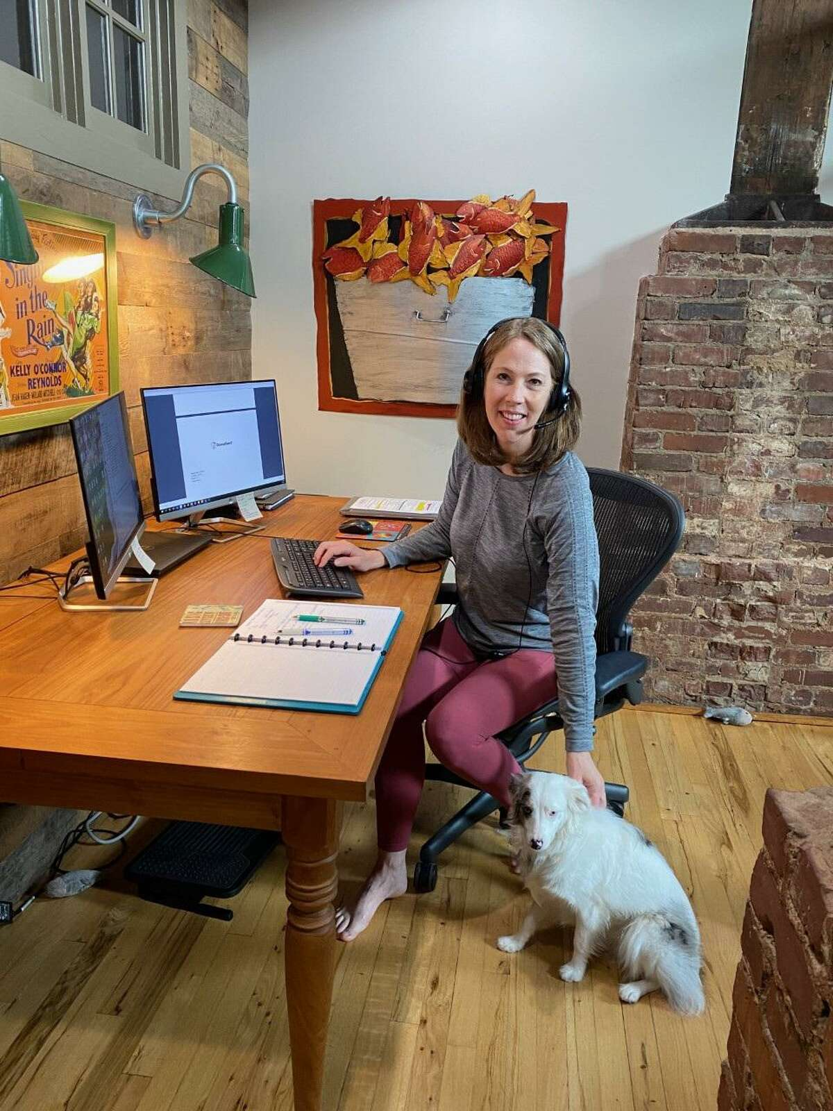 One of the first things Atlanta-based insurance company accountant Amanda Quintana, seen here with the family's COVID-19 rescue Trixie, did after her employer sent workers home in March 2020 was to go shopping for more yoga clothing, which quickly became her go-to pandemic wardrobe.