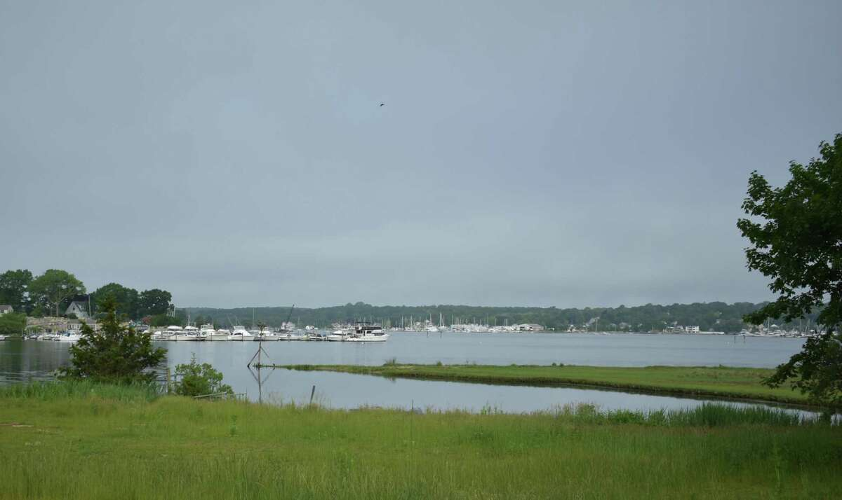 A view of the Mystic River from a strip of land in Stonington, Conn., listed for sale in June 2021 for $35,000. Connecticut land sale transactions tripled over 12 months through June compared to the same stretch a year earlier.