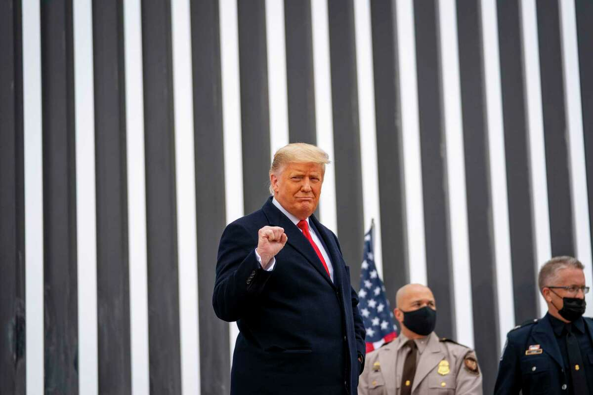 President Donald Trump holds up a fist while touring a portion of the border wall with Mexico, near Alamo, Texas, on Tuesday, Jan. 12, 2021. (Doug Mills/The New York Times)