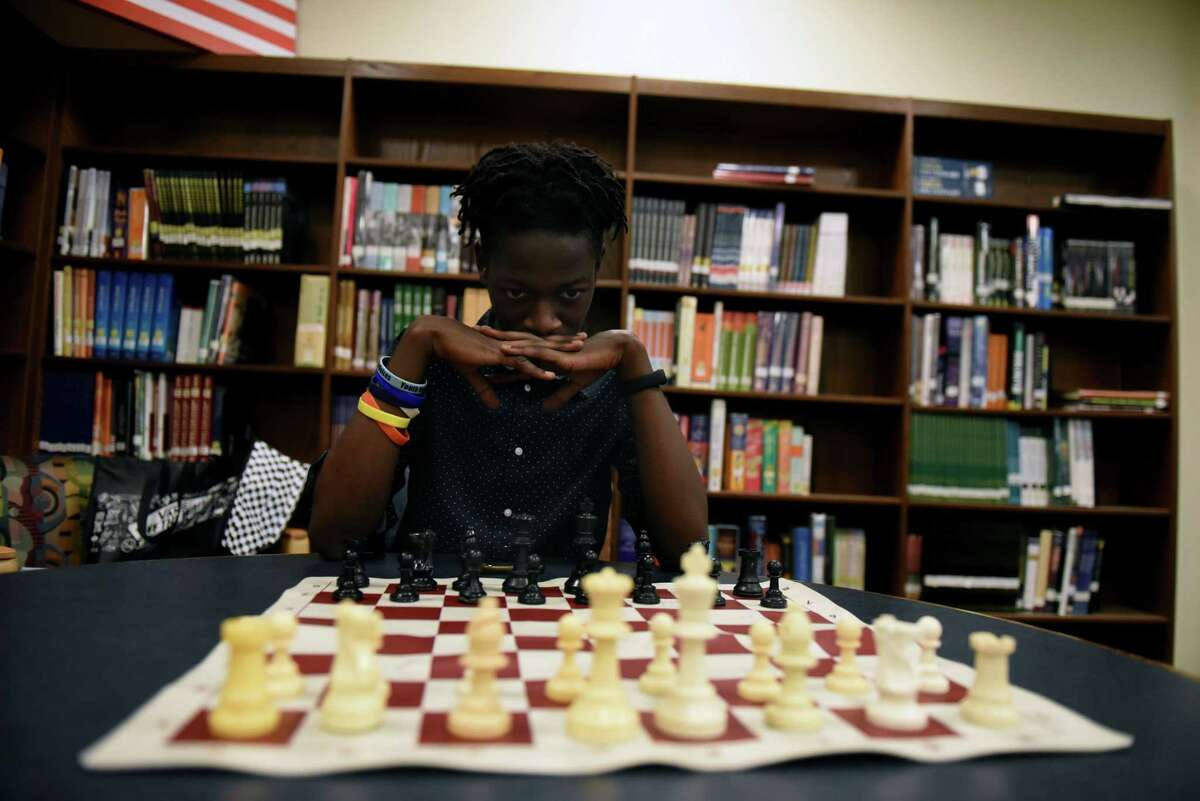 Albany High School senior Danvass Gekonge is pictured in the school library on Friday, June 11, 2021, at Albany High School in Albany, N.Y. Gekonge, who is an avid chess player, will study computer science at Cornell University in the fall. (Will Waldron/Times Union)