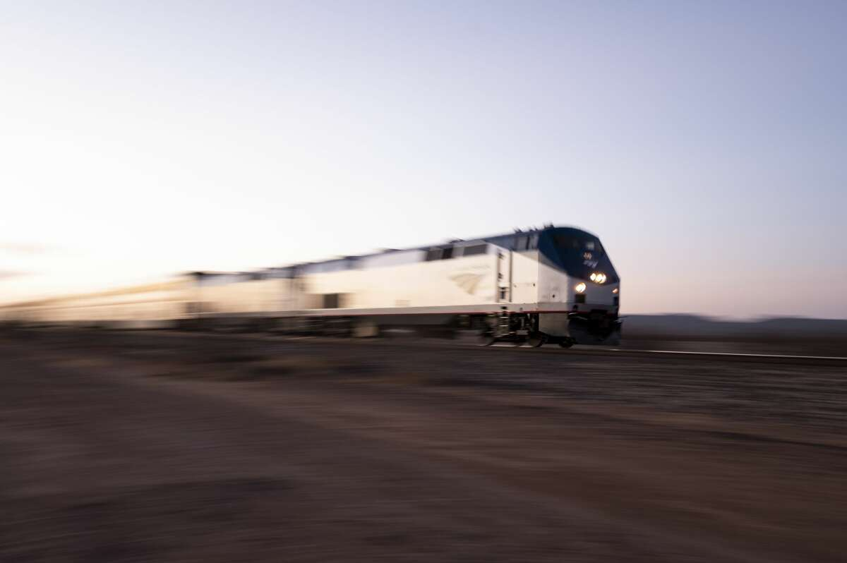 An Amtrak passenger train speeds by near Valentine, Texas on Saturday, April 10, 2021.
