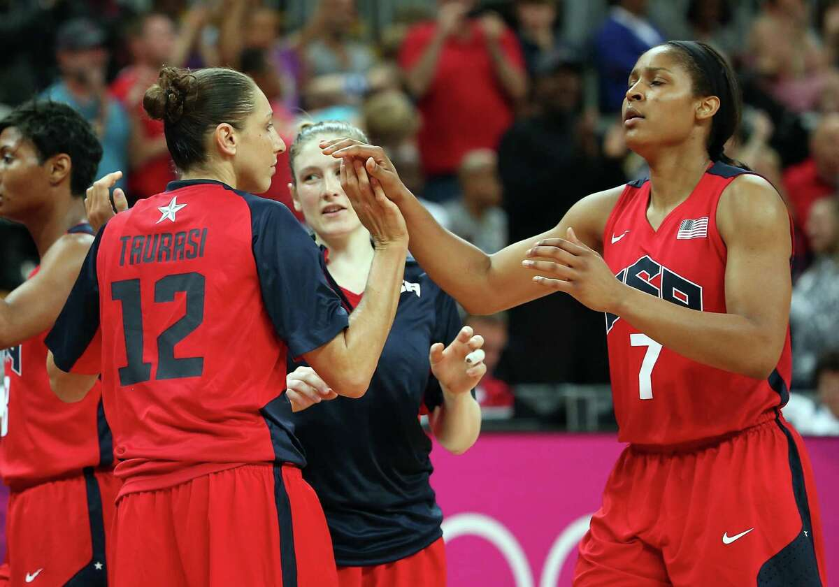 Maya Moore #7 of United States high fives Diana Taurasi #12 after defeating China in the Women's Basketball Preliminary Round match on Day 9 of the London 2012 Olympic Games at the Basketball Arena on August 5, 2012 in London, England.