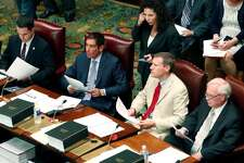 In this 2014 file photo, Diane Savino stands behind four fellow members of the former Independent Democratic Conference (IDC), from left, David Carlucci, Jeffrey Klein, David Valesky, and Tony Avella in the Senate Chamber at the Capitol in Albany, N.Y. They were among the eight New York Democratic state senators who broke with their party to join a group that supported Republican control of the chamber. Valesky was just appointed by Cuomo to serve on the Public Service Commission.